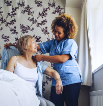 caregiver assiting the senior woman