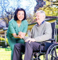 caregiver and senior man smilling