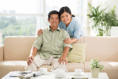 female caregiver hugging senior woman